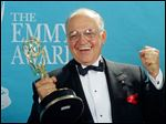 Actor Richard Dysart grasps the Emmy Award he won for Best Supporting Actor in a Drama Series for his role in
