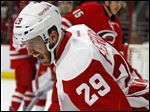 Detroit Red Wings' Landon Ferraro (29) reacts after scoring his first NHL goal during the first period of an NHL hockey game against the Carolina Hurricanes, Saturday, April 11, 2015, in Raleigh, N.C. (AP Photo/Karl B DeBlaker)