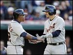 Detroit Tigers' Nick Castellanos, right, celebrates his two-run home run with Yoenis Cespedes in the fifth inning.