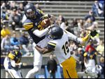 The Gold team's Rolan Milligan forces Cody Thompson to drop a touchdown pass during Toledo's spring game at the Glass Bowl. Defenses dominated much of the day in the Blue team's 6-5 victory.