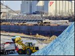 Salt is loaded into a truck at Toledo's salt dock in December. The city began the winter with a 70,000-ton stock­pile, and crews spread 36,244 tons of that during the season.