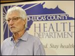 Health Commissioner Dr. David Grossman gives the local response to the suspected Ebola case a B plus or B minus.