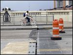 Crews from Toledo Department of Streets, Bridges, and Harbor are replacing four expansion joints on the Martin Luther King, Jr., Bridge in Toledo, which requires closing the span to all traffic during daytime hours over the next three weekends.