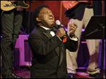 Percy Sledge kneels as he performs 'When a Man Loves a Woman' along with the Muscle Shoals Rhythm Section at the Musicians Hall of Fame awards show in Nashville, Tenn., in October, 2008.