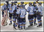 The Walleye embrace one another in celebration after clinching home ice throughout the Kelly Cup playoffs that goes with winning the Brabham Cup for the most points in the East Coast Hockey League. Toledo also led the league in home wins this season with 26 and will open against Wheeling on Thursday.
