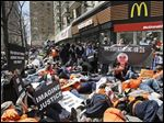 Protesters stage a 'die-in' outside a New York City McDonald's. Fight for $15 protesters linked their struggle to the troubles faced by black men at the hands of police.
