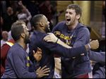 Cleveland Cavaliers' Kevin Love, right, and LeBron James celebrate after a 113-108 overtime win over the Washington Wizards Wednesday in Cleveland.