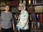 Former Stair District Library director, Liz Stella, 76, and director Colleen Leddy are surrounded by more than 1,500 books that were donated by former Detroit Free Press owner Edward D. Stair in 1941.
