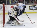 Toledo Walleye player Kyle Rogers (17) can't get the rebound on Wheeling Nailers goalie Franky Palazzese (29).