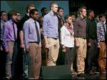 Army recruits, including Randall Aumiller, 18, of Swanton, center, and Melyssa Avalos, 17, of Lake High School, center right, stand to be recognized on stage during the Our Community Salutes event Thursday at Maumee High School's Performing Arts Center.