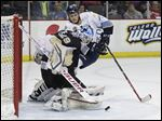 Toledo's Kyle Rogers can't get the rebound on Wheeling Nailers goalie Franky Palazzese during the first period.