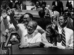 Former U.S. Sen. Robert Griffin, left, is seen behind President Gerald Ford in this 1975 photo in Traverse City, Mich.