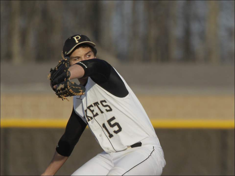 Perrysburg High School starting pitcher Kaleb Mahler throws a pitch.