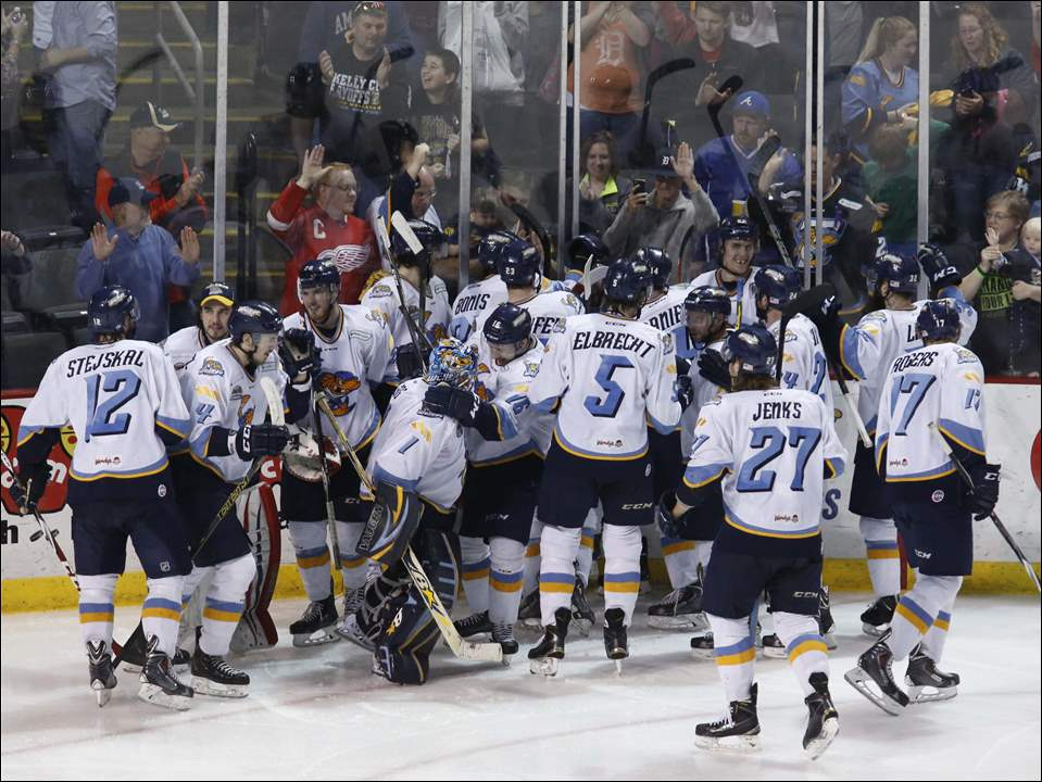 Toledo Walleye players celebrate in front of their fans after the win.