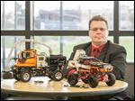 Tony Smoktonowicz and his award-winning methane gas detecting robots at Owens Community College.