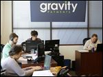 Sales representatives work at Gravity Payments, a credit card payment processor based in Seattle.