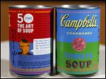 In this photograph taken Aug. 24, 2012, new limited edition Campbell's tomato soup cans with art and sayings by artist Andy Warhol.