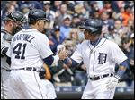 The Tigers' Yoenis Cespedes, right, is congratulated by teammate Victor Martinez after they both scored on Cespedes' two-run home run in the third inning off White Sox pitcher Jose Quintana on Sunday.