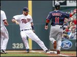 Twins first baseman Joe Mauer touches first as the Indians' Jose Ramirez grounds out in the third inning.