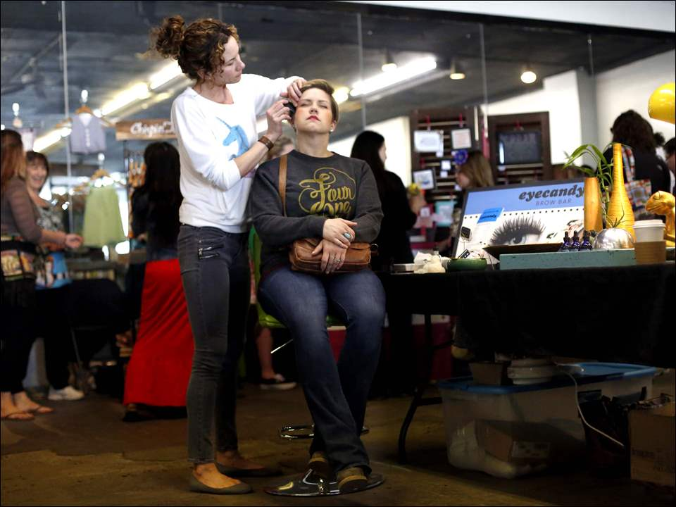 Jill Holt Czerniakowski, left, owner of Eyecandy Brow Bar, performs a Gua Sha treatment on Kiersten Deaton.