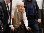 Defendant Oskar Groening arrives in the court room in Lueneburg, northern Germany, today. The  93-year-old former Auschwitz guard faces trial on 300,000 counts of accessory to murder.