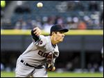 Cleveland starter Trevor Bauer delivers a pitch Monday night in the first inning against the White Sox in Chicago.