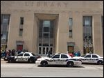 Toledo police vehicles posted outside the Main Library in downtown Toledo Tuesday.