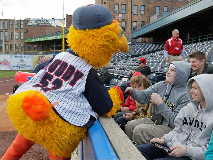 Muddy the Mud Hen jokes around with Birmingham Elementary seventh graders Chris Clarke, left, and Brent Newman, right, before the Hens play the Louisville Bats.