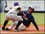 Toledo's Dixon Machado (28) slides safely into second as Louisville Bats player Eugenio Suarez (7) can't make the tag in time during the first inning.