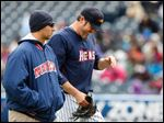 Detroit Tigers pitcher Joe Nathan, on a rehab assignment with the Toledo Mud Hens, leaves Wednesday's game injured with Mud Hens trainer Chris McDonald.