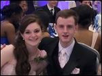 Kaitlin McCarthy and Matty Marcone, who has autism, attend prom at their Canton, Mass., high school. They were crowned prom king and queen.