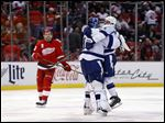 Tampa Bay Lightning goalie Ben Bishop, middle, celebrates with Ryan Callahan as Detroit Red Wings center Pavel Datsyuk (13) skates off the ice after a Tyler Johnson goal in overtime.