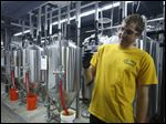 Assistant Brewer, senior chemistry major Stephen Moser, 23, tastes a batch of freshly brewed beer at the recently opened Innovation Brew Works at the California State Polytechnic University.