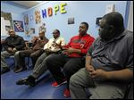 L.C. Everage, left, Ernie Banks, Travis Williams, J'kari Bailey, and Albert Earl, Jr., met recently at an urban health center in Toledo to talk about harassment, unwarranted police stops, and getting mistaken for suspects who looked nothing like them.