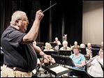 Vietnam War veteran David M. Smith conducts the Owens Community College Concert Band.
