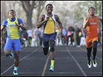 Whitmer's Alex Miles, right, defeats Rosheed Ajala of Findlay in the 100-meter dash at the Eastwood Relays on Friday. Miles was also on two winning relay teams.