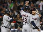 Cleveland's Brandon Moss, right, celebrates his three-run home run with Carlos Santana, left, and Michael Brantley in the fifth inning on Friday.