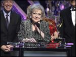 Betty White accepts the lifetime achievement award at the 42nd annual Daytime Emmy Awards Sunday in Burbank, Calif.