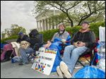 Sean Varsho, 28, of Chicago, left, and Brandon Dawson, 26, of Warrantor, Va., have been waiting since last week for a seat for today's Supreme Court hearing on gay marriage.