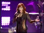 Reba McEntire performs at ACM Presents Superstar Duets at Globe Life Park in Arlington, Texas.