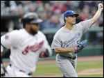 Kansas City Royals starting pitcher Jason Vargas, right, throws out Cleveland Indians' Carlos Santana, left, at first base in the first inning Monday in Cleveland.