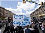 People gather Tuesday in Baltimore, in the aftermath of rioting after Monday's funeral for Freddie Gray, who died in police custody.