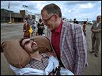 This July 11, 2013, photo shows Jim Obergefell, right, and John Arthur after they returned from their wedding flight at Landmark Aviation at Cincinnati's Lunken Airport. The couple were married during a short ceremony on the plane, on the tarmac, at Baltimore/Washington International Thurgood Marshall Airport, after flying in from Cincinnati.  John suffers from ALS, is bed-ridden, and is now in hospice care. A federal judge has ruled in favor of the two Ohio men who want their out-of-state marriage recognized John nears death, a case that's seen as encouraging for same-sex marriage supporters in Ohio.