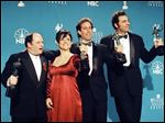 'Seinfeld' cast members, from left, Jason Alexander, Julia Louis-Dreyfus, Jerry Seinfeld and Michael Richards pose together backstage after they won Outstanding Performance by an Ensemble in a Comedy Series at the Screen Actors Guild Awards, in Los Angeles in 1997.