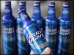 Anheuser-Busch is apologizing for ad copy on bottles saying Bud Light removes 'no' from drinkers' vocabulary. The slogan is part of the 'Up for Whatever' campaign.
