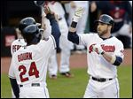 Cleveland Indians' Jason Kipnis, right, is congratulated by Michael Bourn, left, and Roberto Perez after Kipnis hit a three-run homer.