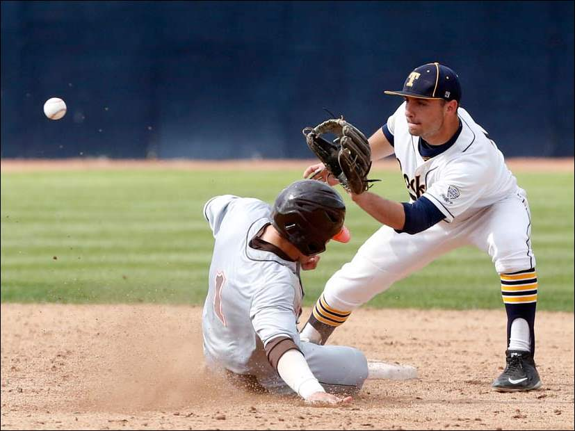 University of Toledo's second baseman Matt Hansen waits for the ball while Bowling Green State University's  Trey Kegan slides safely into second base.