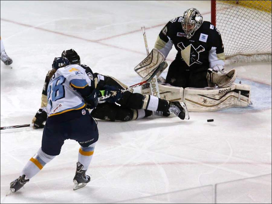 Toledo's Kyle Bonis scores against Wheeling goalie Eric Hartzell during the first period.