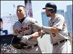 Detroit Tigers' James McCann, left, is congratulated by Nick Castellanos after his inside-the-park home run.