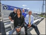 Athletic Director Frank Kohlhofer, back left, Principal Rhonda Jemison, softball coach Rob Gwozdz, back right, and Superintendent Michael O'Shea look